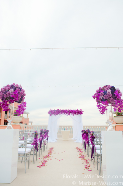la-vie-en-rose-phalaenopsis-orchid-alter-structure-white-columns-petals-arrangement-purple-lavender-ceremony-hyatt-clearwater-beach-florida