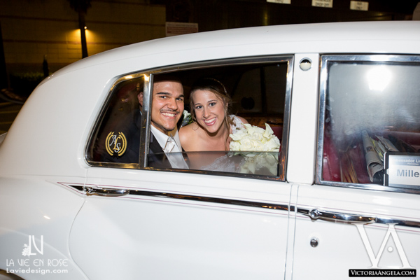 la-vie-en-rose-wedding-exit-white-rolls-royce-florida-aquarium-tampa
