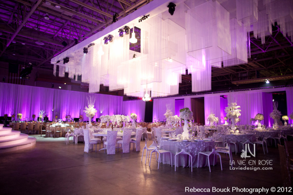 la-vie-en-rose-special-event-jouney-to-love-white-guest-table-modern-centerpiece-reception-purple-up-light-tampa-florida