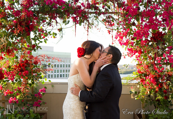 la-vie-en-rose-wedding-ceremony-structure-bougainvilliea-grapes-orchid-amaranthus-berries-bride-groom-westin-tampa-bay-florida