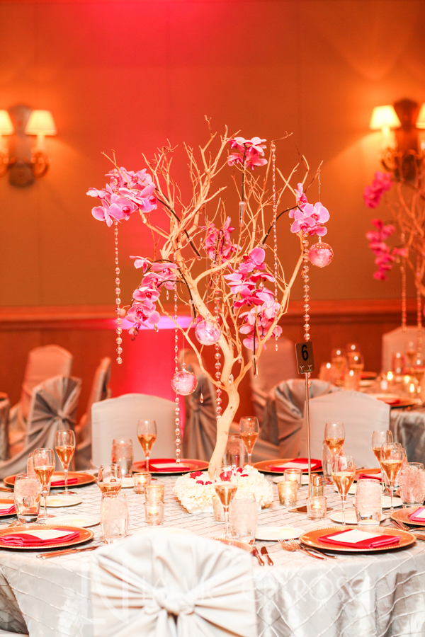 la-vie-en-rose-wedding-silver-chair-cover-linens-LED-up-lighting-guest-table-centerpiece-tree-hanging-crystal-strand-globes-phalaenopsis-orchid-drape-hyatt-regency-clearwater-beach-florida