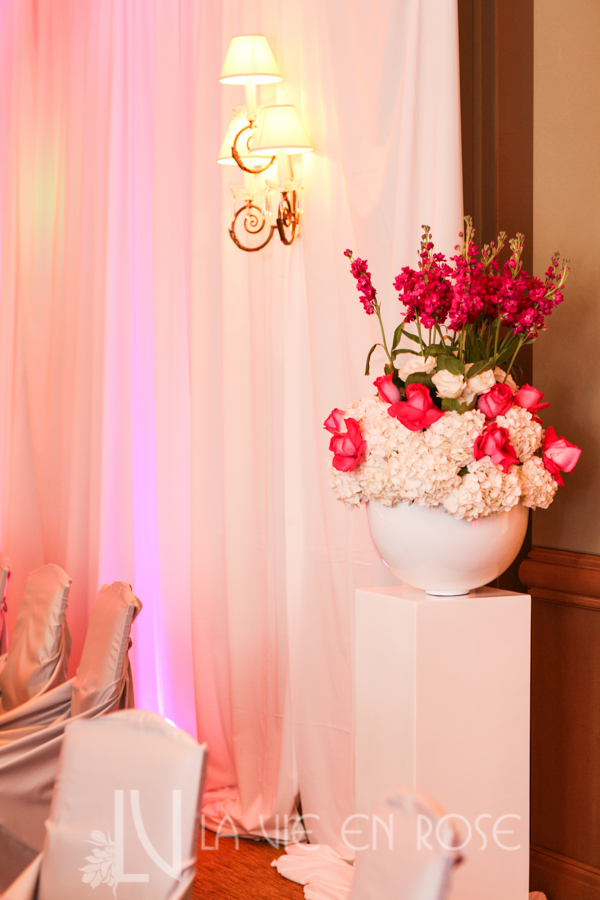 la-vie-en-rose-wedding-silver-chair-cover-linens-LED-up-lighting-guest-table-peonies-phalaenopsis-orchid-hydrangea-mini-calla-pink-drape-hyatt-regency-clearwater-beach-florida