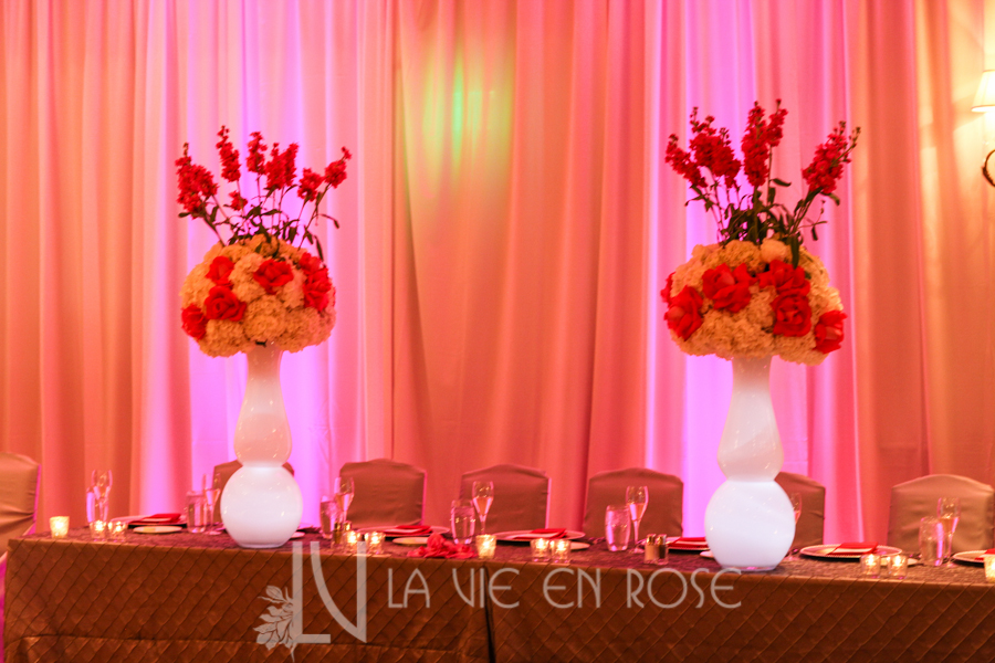 la-vie-en-rose-wedding-centerpiece-silver-chair-cover-linens-LED-up-lighting-head-table-peonies-phalaenopsis-orchid-hydrangea-mini-calla-pink-hyatt-regency-clearwater-beach-florida