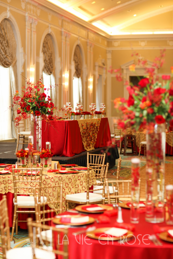 la-vie-en-rose-red-gold-chargers-guest-table-chiavari-chair-up-light-centerpiece-overlay-floating-candle-cymbidium-orchid-mokara-orchid-freesia-ranunculus-tulip-mini-calla-vinoy-renaissance-saint-petersburg-resort-and-golf-club-florida