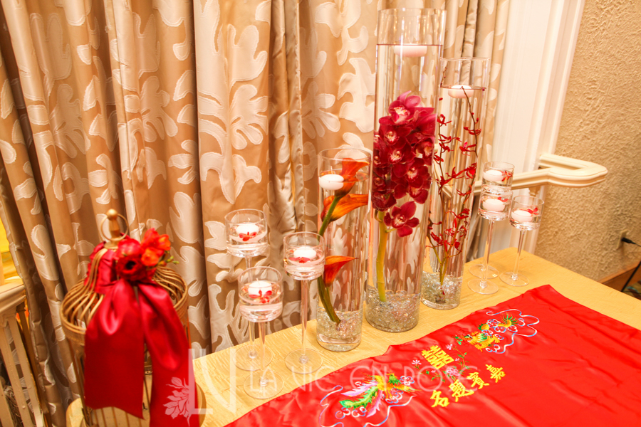 la-vie-en-rose-red-gold-gift-table-centerpiece-cocktail-hour-floating-candle-cymbidium-orchid-vinoy-renaissance-saint-petersburg-resort-and-golf-club-florida