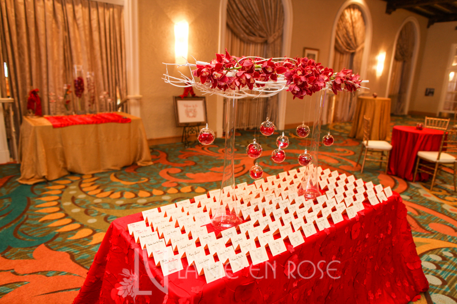la-vie-en-rose-red-gold-card-table-centerpiece-hanging-globes-branches-white-cocktail-hour-cymbidium-orchid-vinoy-renaissance-saint-petersburg-resort-and-golf-club-florida