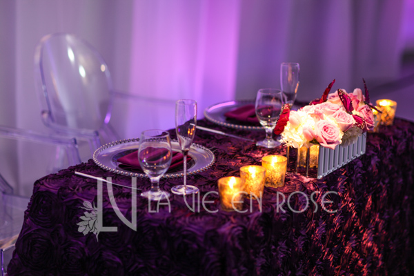la-vie-en-rose-reception-rosette-linen-sweetheart-table-candle-centerpiece-wedding-purple-venue-tampa-florida