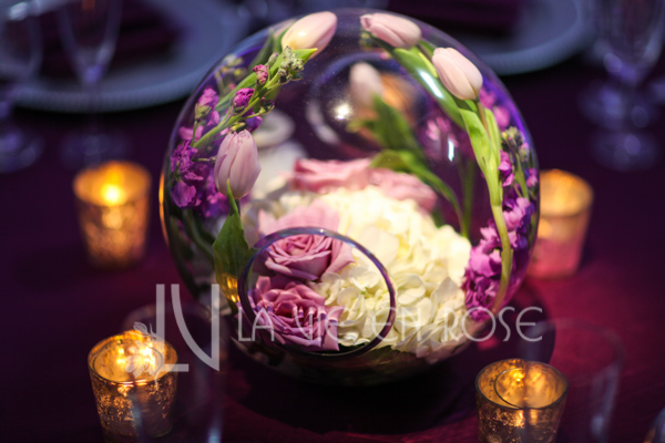 la-vie-en-rose-reception-guest-table-centerpiece-tulip-white-hydrangea-globe-pin-light-candle-wedding-purple-venue-tampa-florida