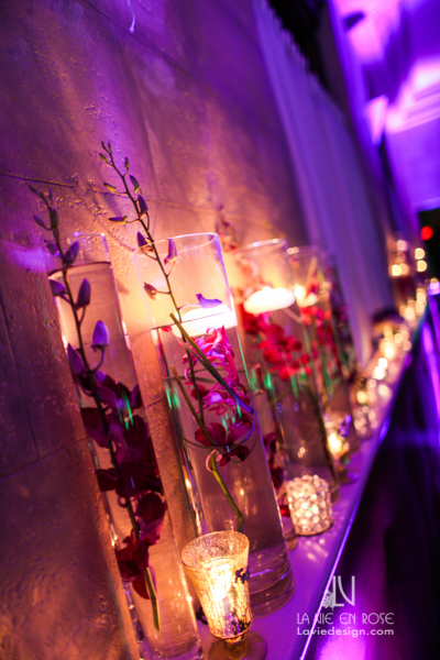 la-vie-en-rose-tampa-bay-metro-magazine-mise-place's-lafayette-room-baisden-gallery-green-purple-white-light-candle-votives-mantle