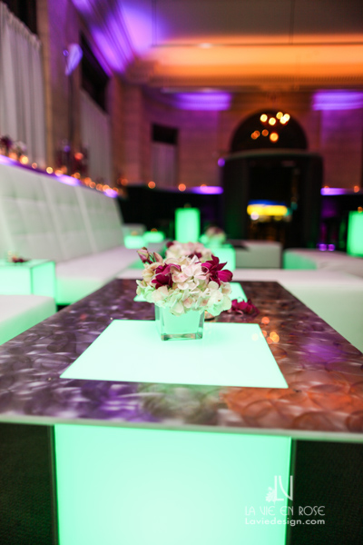 la-vie-en-rose-tampa-bay-metro-magazine-mise-place's-lafayette-room-baisden-gallery-green-purple-white-light-lounge-furniture-spray-arrangement