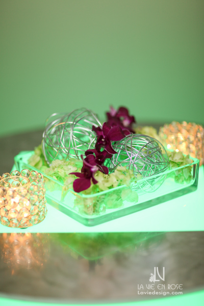 la-vie-en-rose-tampa-bay-metro-magazine-mise-place's-lafayette-room-baisden-gallery-green-purple-white-light-wire-glass-candle