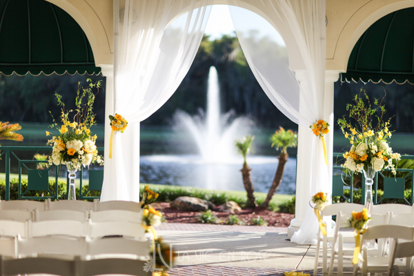 la-vie-en-rose-wedding-ceremony-orchid-daffodils-hyacinths-gerber-tulip-ivories-stock-hydrangea-petals-yellow-fountain-alter-arrangement-tampa-palms-golf-and-country-club-florida