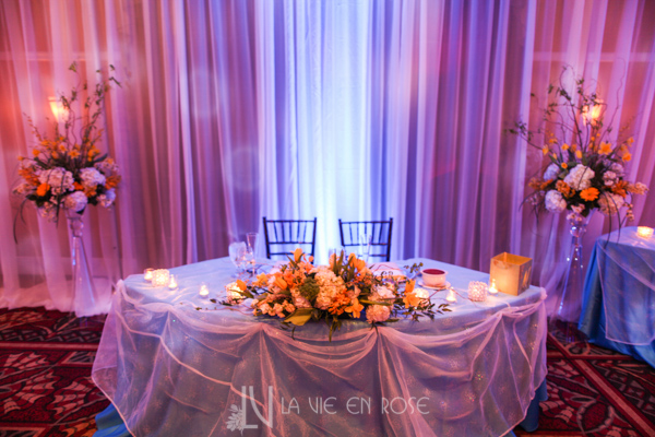 la-vie-en-rose-wedding-reception-orchid-daffodils-hyacinths-gerber-stock-hydrangea-yellow-centerpiece-arrangement-sweetheart-table-tampa-palms-golf-and-country-club-florida