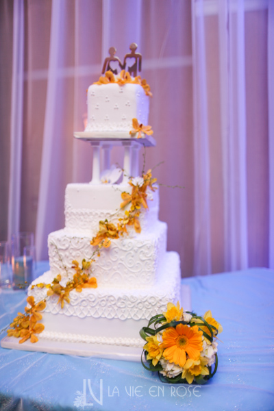 la-vie-en-rose-wedding-reception-orchid-daffodils-hyacinths-gerber-tulip-stock-yellow-white-cake-table-tampa-palms-golf-and-country-club-florida