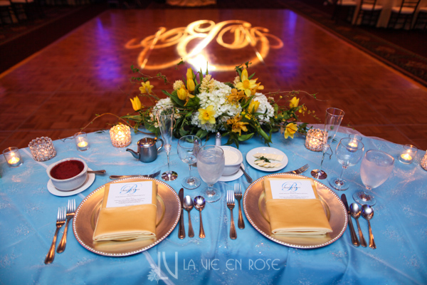 la-vie-en-rose-wedding-reception-dance-floor-yellow-pin-light-sweetheart-monogram-charger-gold-centerpeice-table-tampa-palms-golf-and-country-club-florida