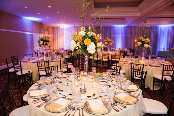 la-vie-en-rose-wedding-reception-orchid-daffodils-hyacinths-gerber-stock-hydrangea-yellow-centerpiece-arrangement-charger-gold-votives-tampa-palms-golf-and-country-club-florida