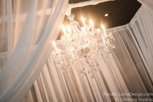 la-vie-en-rose-drape-ceremony-chuppah-crystal-chandelier-atrium-blush-pink-white-ivory-intercontinental -tampa-florida