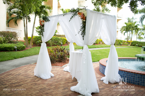 la-vie-en-rose-wedding-chuppa-white-peach-ivory-rose-italianruscus-hydrangea-flower-safety-harbor-resort-spa-clearwater-draping-florida