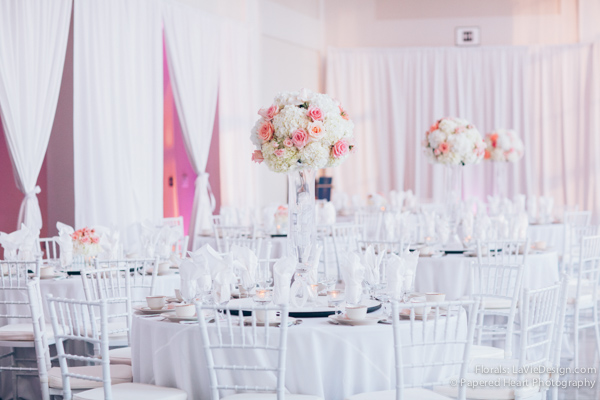 la-vie-en-rose-wedding-reception-tall-vase-arrangement-white-hydrangea-pink-chivari-drape-lighting-the-vault-downtown-tampa-florida