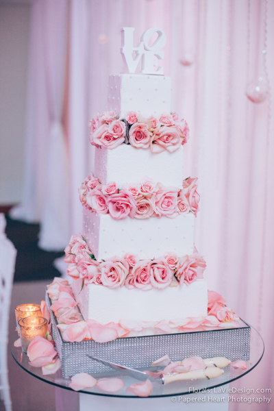 la-vie-en-rose-wedding-reception-three-tier-cake-pink-mercury-votive-drape-the-vault-downtown-tampa-florida