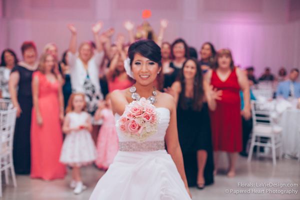 la-vie-en-rose-wedding-reception-bride-toss-bouquet-white-hydrangea-party-the-vault-downtown-tampa-florida