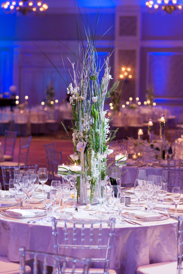 la-vie-en-rose-wedding-reception-table-linens-centerpiece-candles-glass-beaded-chargers-floral-arrangements-hydrangeas-white-roses-hypericum-berries-green-fern-tulips-calla-lily-menu-napkins-floating-candle-stems-elegant-romantic-love-specialty-linen-happily-ever-after-waldorf-astoria