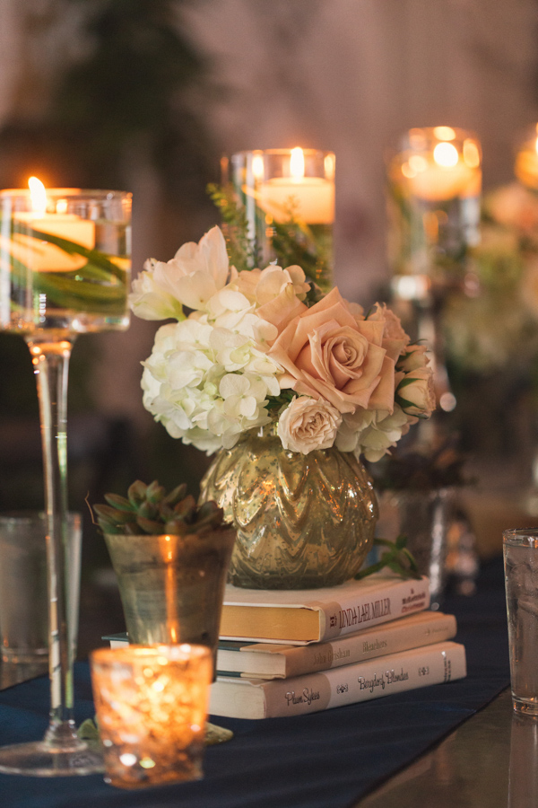 la-vie-en-rose-wedding-reception-ceremony-downtown-tampa-bay-invitation-bride-and-groom-floral-decor-centerpieces-books-gold-mercury-vase-roses-hydrangea-green-fern-spray-rose-candles-stems-ecclectic-succulent-votive-candles-birchwood-branch-moss-navy-table-runner-the-oxford-exchange