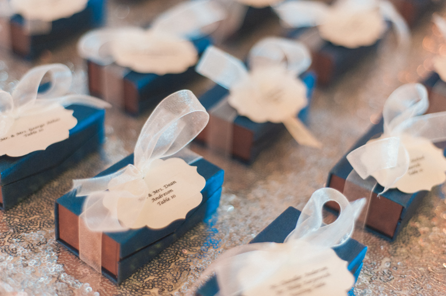 la-vie-en-rose-tampa-bay-Clearwater-wedding-reception-party-favors-william-dean-chocolates-blue-box-white-ribbon-bow-silver-sequin-overlay-linen-romantic-elegant-Ruth-Eckerd-Hall