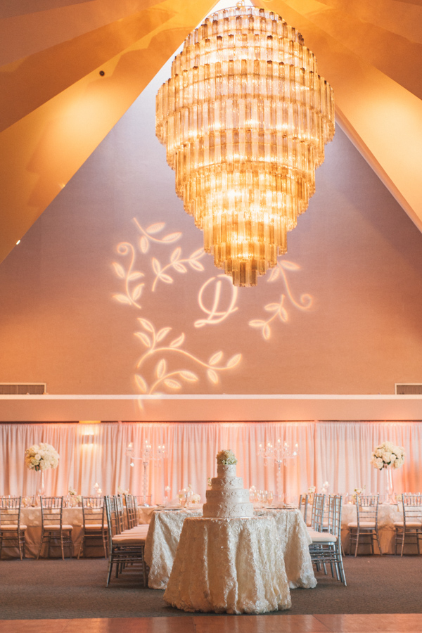 la-vie-en-rose-tampa-bay-Clearwater-wedding-reception-cake-table-decor-lighting-monogram-crystal-candelabra-floral-arrangements-table-specialty-linens-dupioni-wedding-party-roses-hydrangeas-white-ivory-linens-lace-specialty-overlay-napkins-romantic-elegant-Ruth-Eckerd-Hall