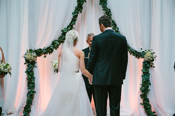 la-vie-en-rose-tampa-bay-Florida-wedding-bride-groom-wedding-love-ceremony-reception-backdrop-drapes-drapery-sheer-flowers-bridal-bouquet-boutonniere-greenery-garland-white-blooms-trendy-fashion-blush-ivory-elegant-The-Oxford-Exchange