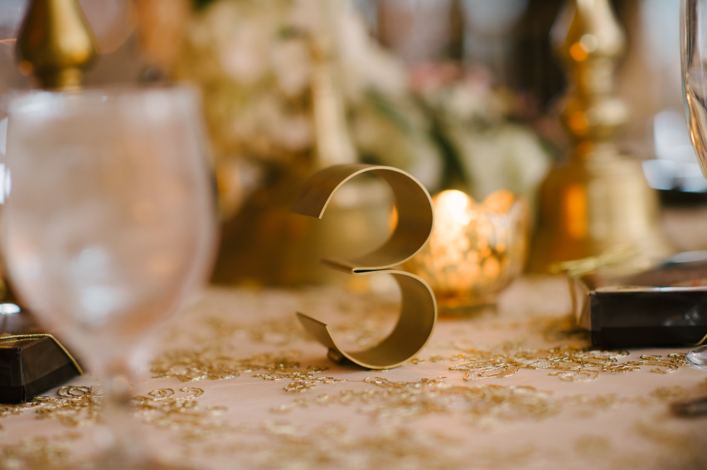 La-vie-en-rose-st-pete-florida-wedding-table-number-metal-reception-gold-overlay-linen-elegant-vinoy