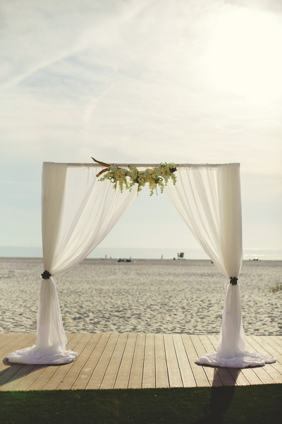 La-vie-en-rose-clearwater-beach-florida-wedding-gorgeous-ceremony-arch-drape-white-ivory-blush-flower-succulent—driftwood-elegant-sandpearl